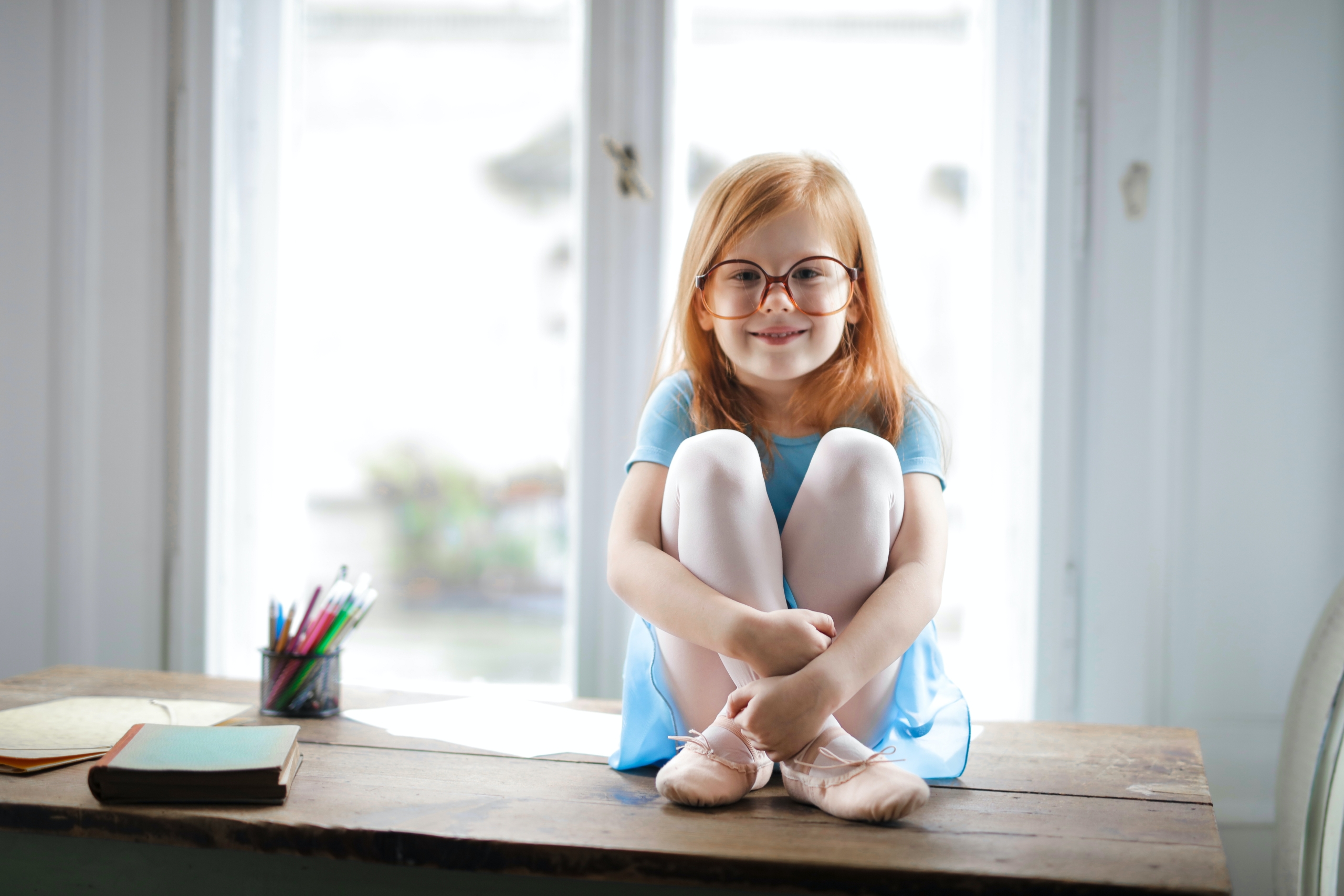Girl Sitting on Table