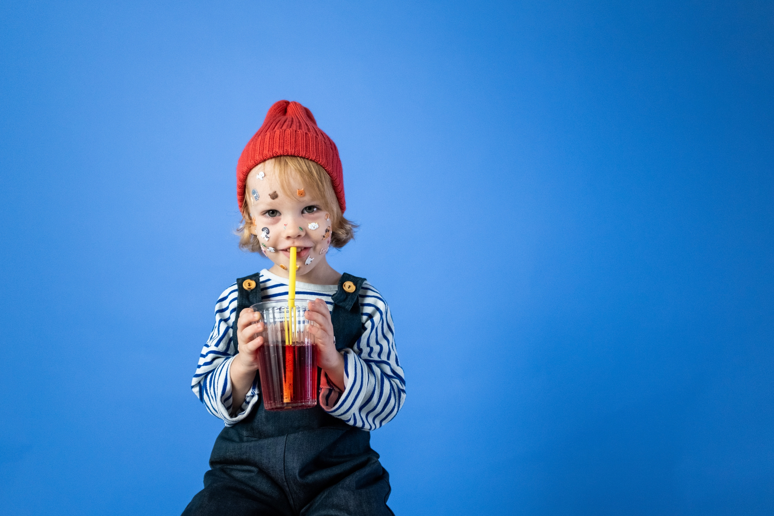 Child Drinking From Cup