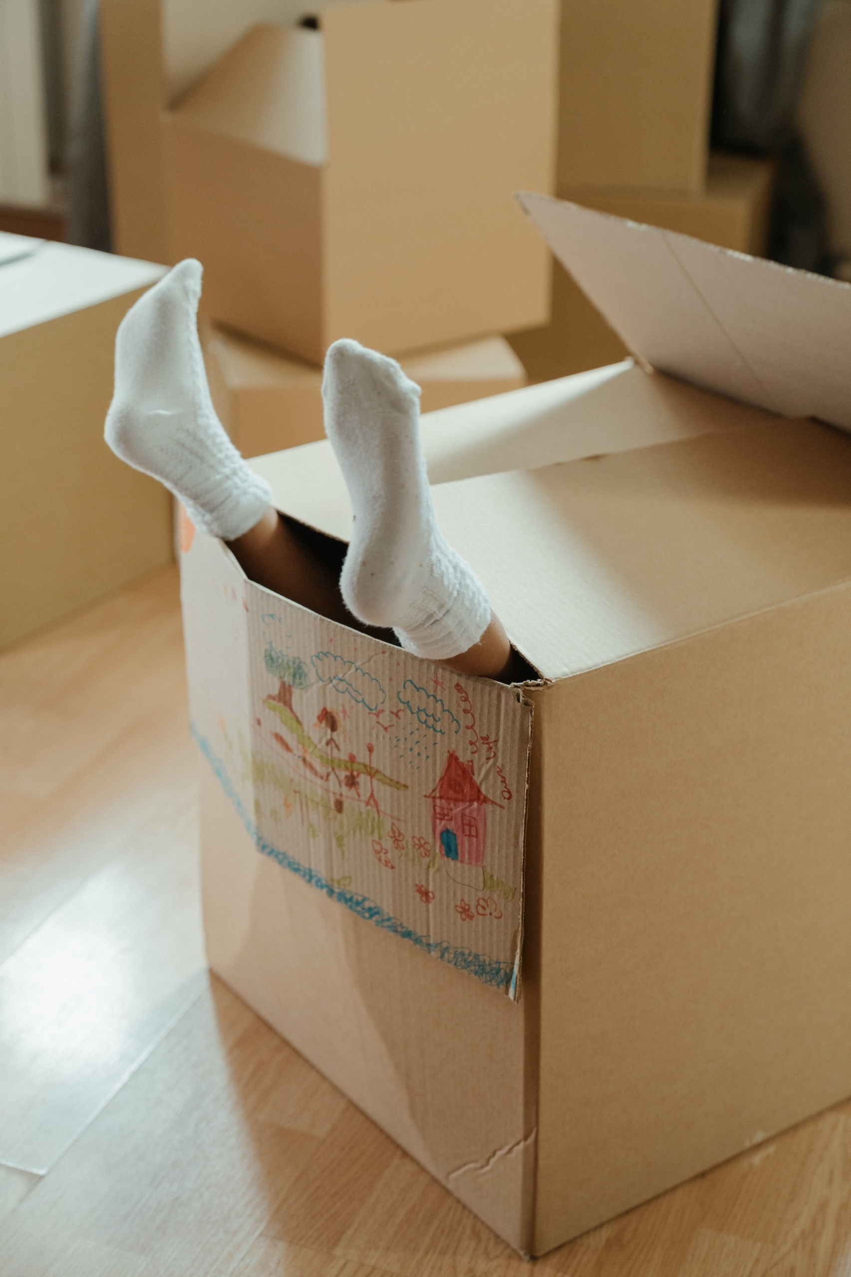 Kid in Box with Feet